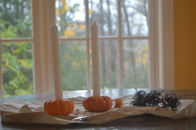 Place Candles in Pumpkin Holders