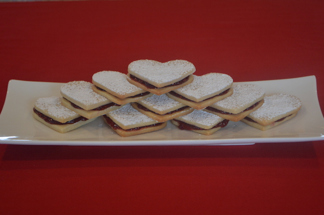A plate of Heart-Shaped Sandwich Sugar Cookies