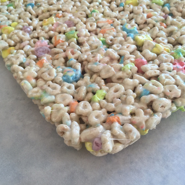 remove from pan Lucky Charms Marshmallow Treats for St. Patrick's Day