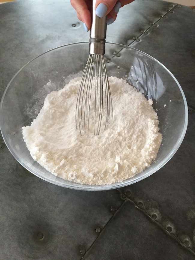 blending dry ingredients for Easter Egg Bath Bombs